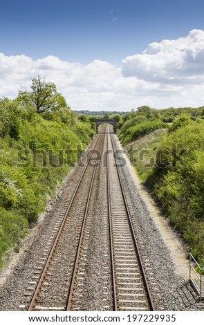 Two railway tracks through English countryside viewed from above - stock photo
