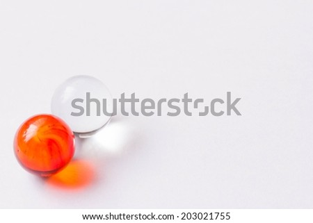 Two red and clear glass marbles - Lower left - stock photo