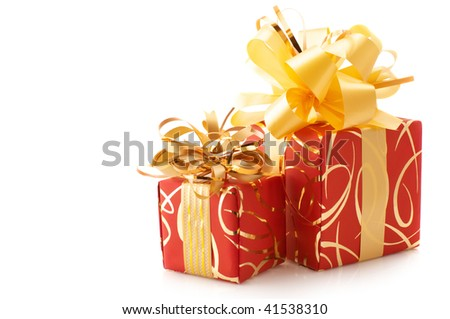 Two red and gold gifts isolated on white background.