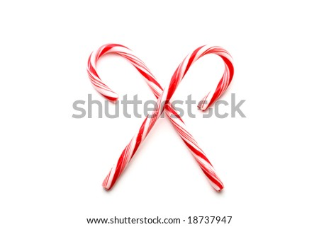 Two red and white Christmas candy canes, isolated on white - stock photo