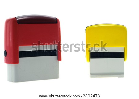 Two red and yellow rubber stamps - stock photo