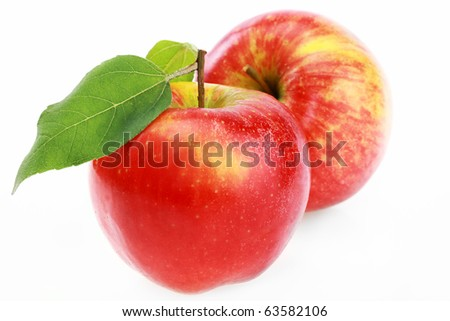 Two red apple and half of red apple isolated on a white background.