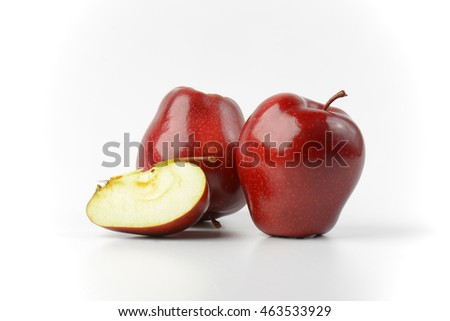 two red apples on off-white background