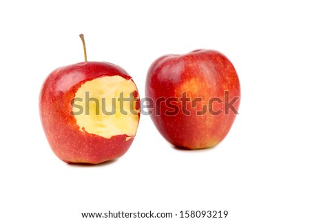 Two red apples whole and bitten. Isolated on a white background. - stock photo