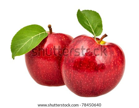 Two red apples with leaves - stock photo