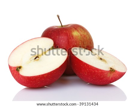 Two red apples with one sliced in half. They are Haralsons, but look like fuji or gala as well. - stock photo