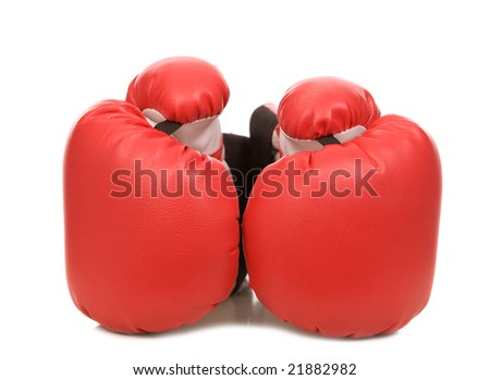 two red boxing gloves on a white background close-up - stock photo