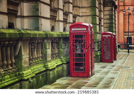Two red british telephone booths in the historical center of the Birmingham, UK - stock photo