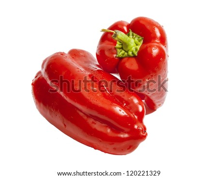 Two red bulgarian peppers isolated on white - stock photo
