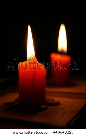 two red candles in the dark