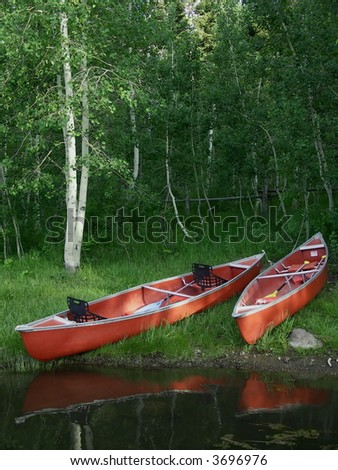 Two red canoes