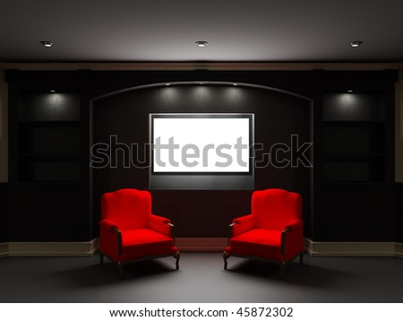 Two red chairs with LCD tv in dark living room - stock photo