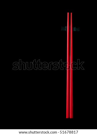 Two red chopsticks isolated on black background - stock photo