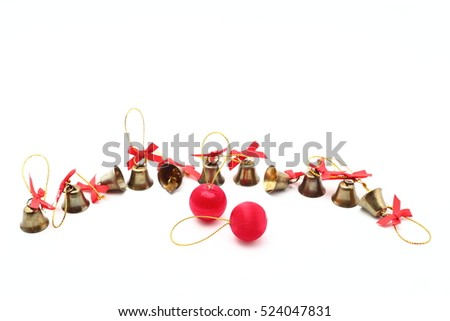 two red christmas balls and golden bells with a red bowwith ribbon on a white background