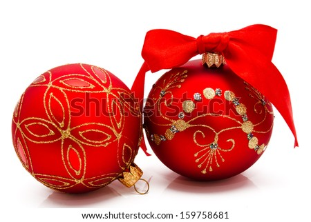 Two red christmas balls with ribbon isolated on a white background