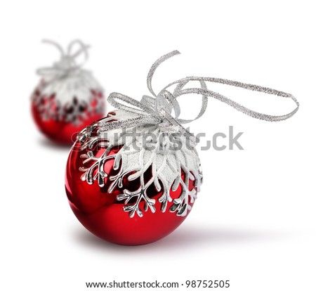 Two red Christmas balls with snowflake decoration, isolated on white - stock photo