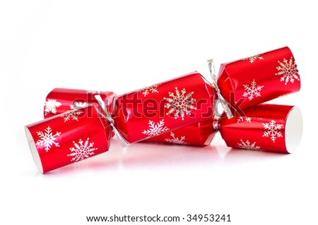 Two red Christmas crackers isolated on white - stock photo