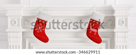 Two red christmas stockings hanging on carved marble stone fireplace 3d rendering - stock photo