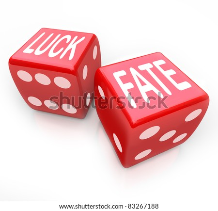 Two red dice featuring the words Luck and Fate representing putting your future at risk when you gamble for money in a game of chance and fortune - stock photo