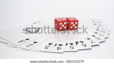 Two red dices and playing cards