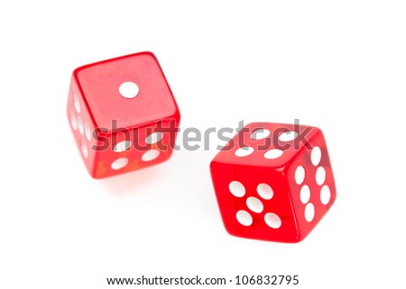 Two red dices moving against a white background - stock photo