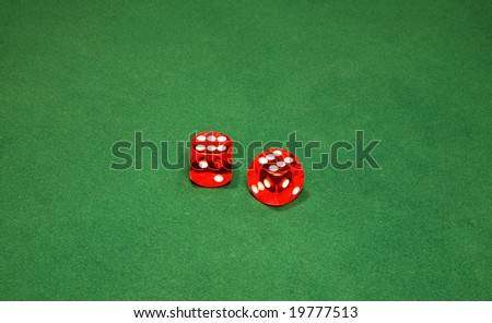 Two red dices on the green table in casino - stock photo