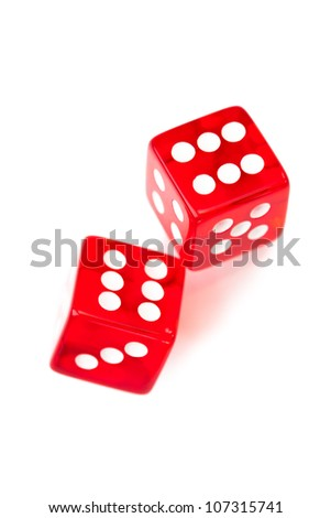 Two red dices rolling against a white background - stock photo