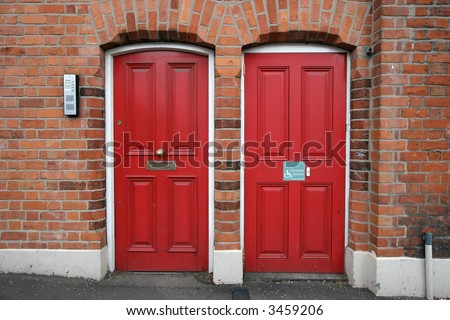 two red doors next to each other