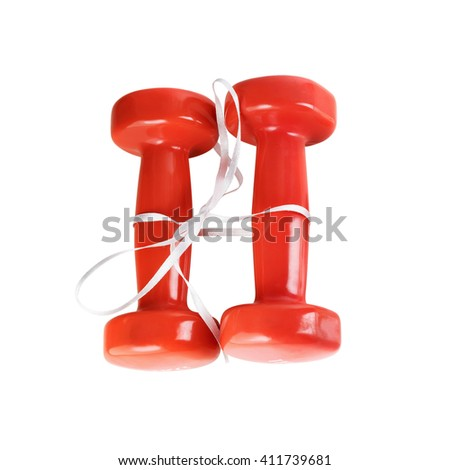 Two red dumbbell. Red dumbbells tied with satin ribbon. Isolated with clipping path on white background. Top view. - stock photo
