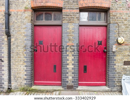 Two red entry doors of a typical London residence - stock photo