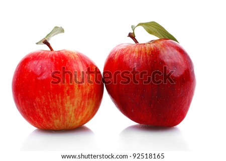two red fresh ripe apple isolated over white background