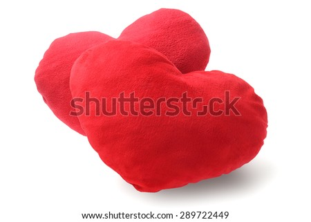 Two Red Heart Cushions on White Background - stock photo