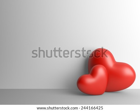 Two red hearts near to a wall. lover concept.  - stock photo