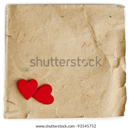 two red hearts on vintage paper with copyspace for text on white background