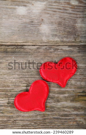 Two red hearts on wooden background. Valentines day background.