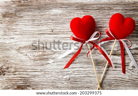 Two red hearts on wooden background. Valentines Day card. Love concept  - stock photo