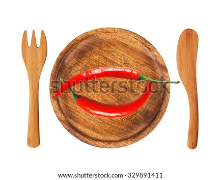 Two red hot chilli peppers on wooden background isolated on white - stock photo