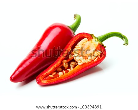 Two red hot peppers over white - stock photo