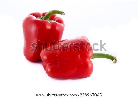 Two red peppers isolated on a white background - stock photo