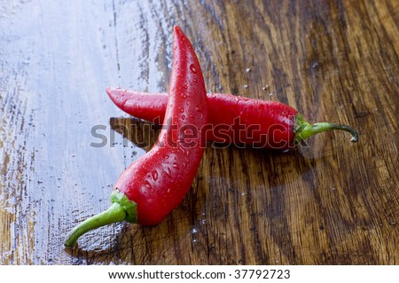 Two red peppers on  the preparation table - stock photo