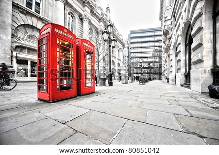 two red phone booths on the street - stock photo