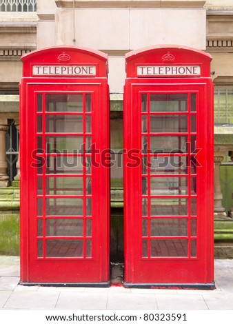 Two red phone booths, typical British Icons - stock photo
