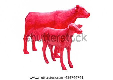 Two red plastic cow isolated on white background - stock photo