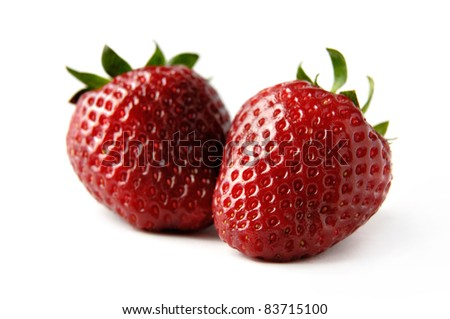 Two red strawberries Isolated close-up over white background - stock photo