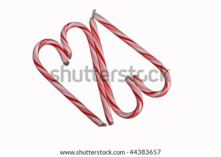 Two red striped candy cane hearts shapes formed by four candy canes.