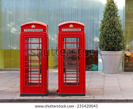 Two red telephone booths in central London - stock photo