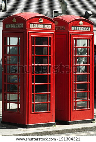 Two red telephone boxes in London, UK - stock photo