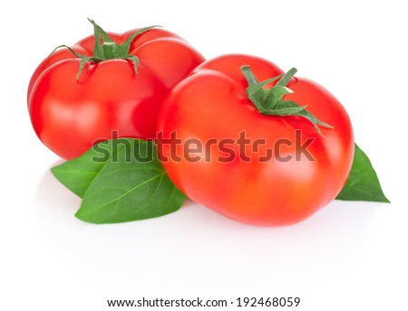 Two red tomatoes and leaves isolated on a white background - stock photo