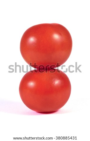 Two red tomatoes macro or close up on each other isolated on white background - stock photo