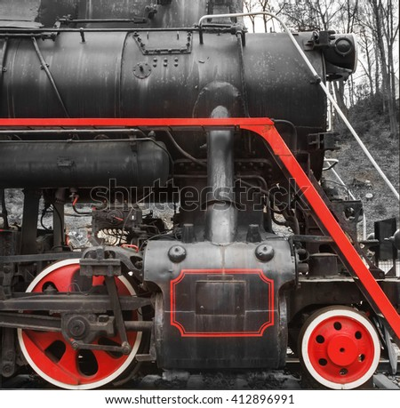 Two red  train wheels of an old steam locomotive  - stock photo